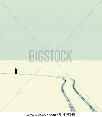 Abstract Vintage Photo Silhouette Of A Man On The Road In Winter Empty Field
