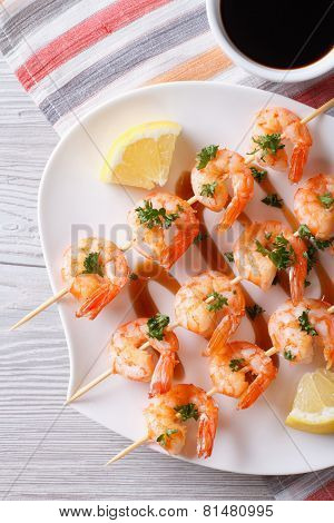 Grilled Shrimp On Skewers With Lemon Close-up. Vertical Top View