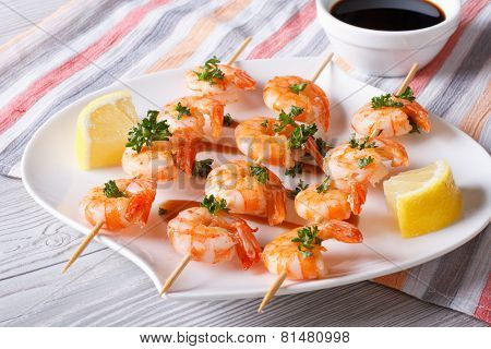Grilled Shrimp On Skewers With Lemon And Sauce Horizontal