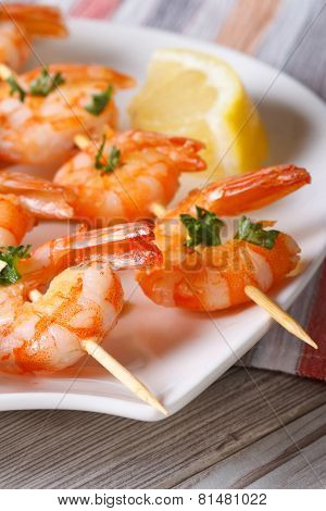 Delicious Fried Shrimp On Wooden Skewers Macro. Vertical