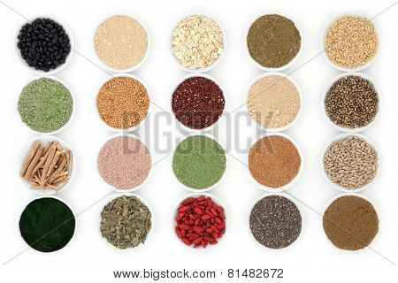 Health food and body building powders in porcelain dishes over white background.