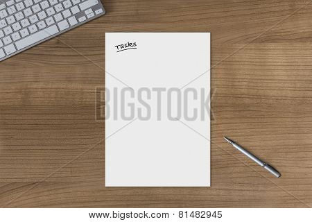 Blank Sheet Tasks On A Wooden Table