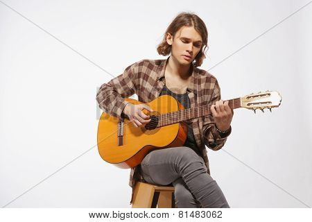 Young guitar player singing a song