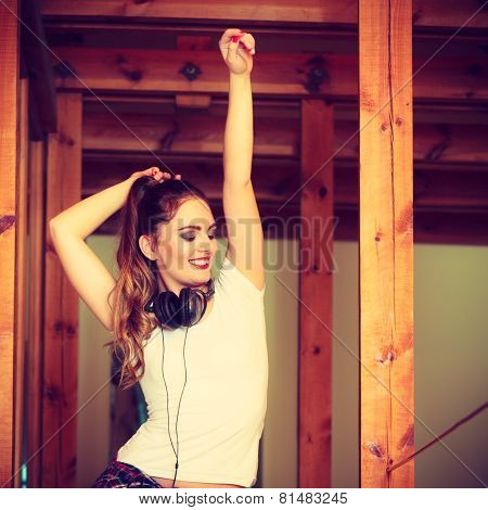 Teen Girl In Headphones Listening Music