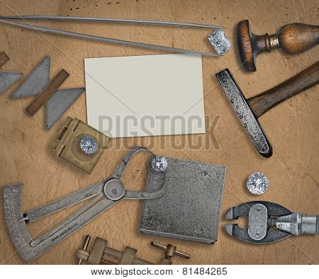 vintage jeweler tools and diamonds over  working bench, blank business card for your text