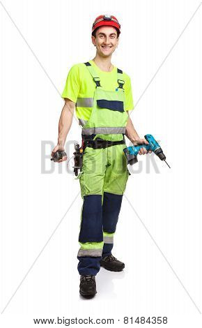 Handsome contractor holding electric screwdriver