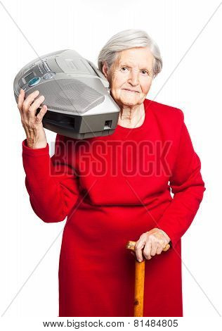 Senior woman while carrying stereo recorder