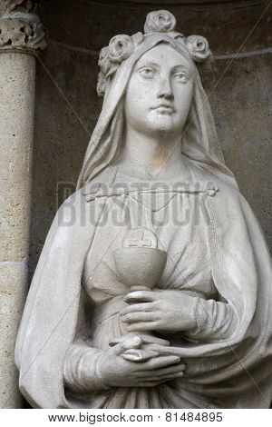ZAGREB, CROATIA - SEP 26: statue of Saint Barbara on the portal of the cathedral dedicated to the Assumption of Mary and to kings Saint Stephen and Saint Ladislaus in Zagreb on Sep 26, 2013.