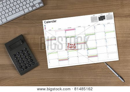 Calendar Due Date And Calculator On Wooden Table