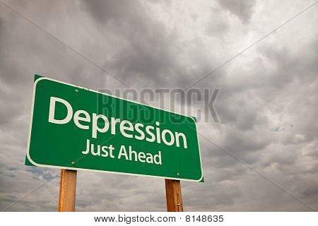 Depression Green Road Sign Over Storm Clouds