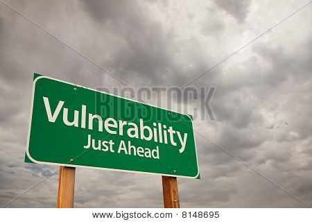 Vulnerability Green Road Sign Over Storm Clouds