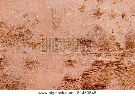 Dark chocolate bar's coarse surface background