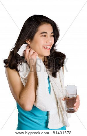 Beautiful Biracial Teenage Girl Drinking Water While Wiping Off Sweat