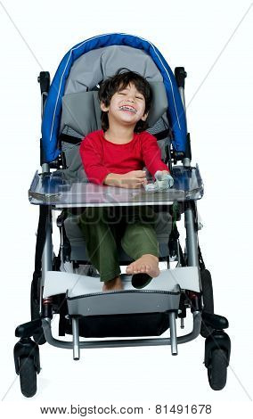 Three Year Old Biracial Disabled Boy In Medical Stroller, Happy And Smiling
