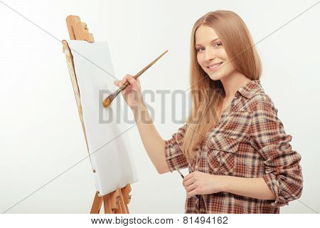 Young beautiful artist creating a masterpiece