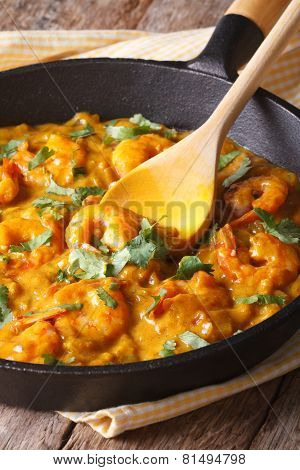 Prawns In Curry Sauce In A Frying Pan Close-up. Vertical