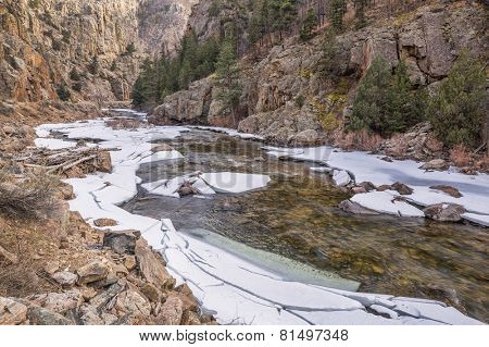 Cache la Poudre River at Big Narrows west of  Fort Collins in northern Colorado - winter scenery with a partially frozen river
