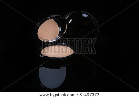 Compact Pressed Powder on Black Background