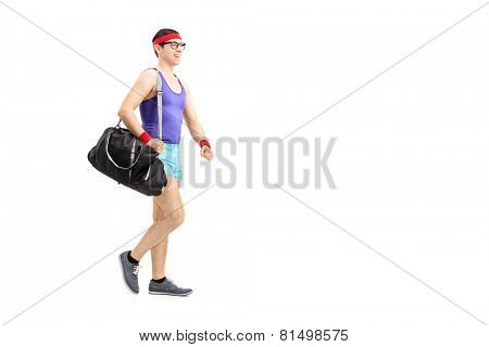 Full length portrait of a nerdy athlete waking isolated on white background