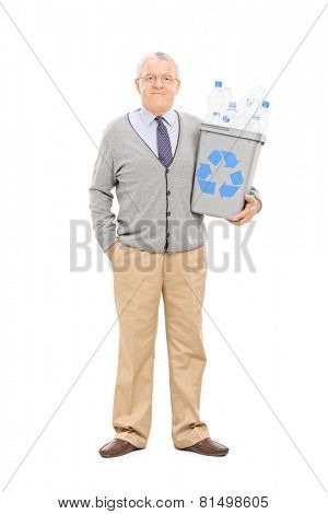 Full length portrait of a senior gentleman holding a recycle bin isolated on white background