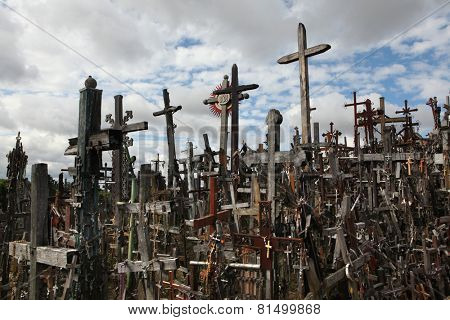 SIAULIAI, LITHUANIA - AUGUST 2, 2013: Wooden crosses at the Hill of Crosses, the most important Lithuanian Catholic pilgrimage site located near the town of Siauliai in Northern Lithuania.