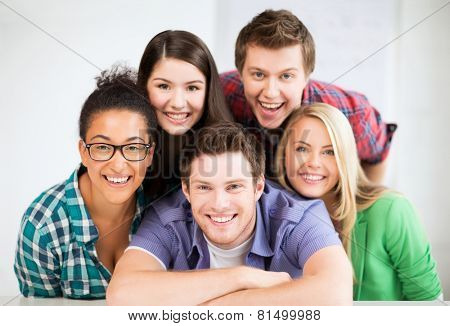 education concept - group of students at school