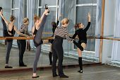 image of ballet barre  - Choreographer helping young ballet dancer to have right position - JPG