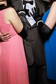 stock photo of threesome  - Elegant people ready for night out - JPG