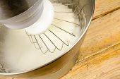picture of food preparation tools equipment  - Egg whites being whisked inside a modern food processor - JPG