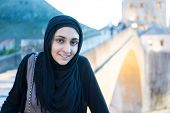 pic of middle eastern culture  - Arabic Muslim Middle Eastern girl traveling for vacation in Mostar bridge - JPG