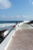 foto of gulf mexico  - View of the promenade on the eastern shore of the ocean in Isla Mujeres - JPG