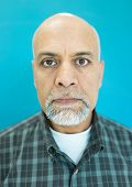 foto of pakistani  - Senior Arabic Pakistani man studio portrait - JPG