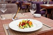 foto of tartar  - Tuna tartar with cucumber and orange on restaurant table - JPG