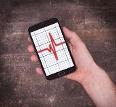 stock photo of electrocardiogram  - Electrocardiogram on a smartphone  - JPG