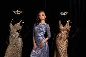 image of dress mannequin  - fashionable woman posing in blue dress with rhinestones and mannequins