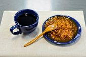image of sea-buckthorn  - Cup of black tea and a saucer of jam from sea buckthorn and a wooden spoon - JPG