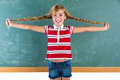 foto of braids  - Braided student blond girl playing in green chalkboard with braids at school classroom - JPG