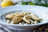 stock photo of sauteed  - Lemon Chicken with Sauteed Chard and Pine Nuts - JPG