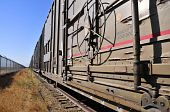 foto of boxcar  - A long line of railroad boxcars on a siding - JPG
