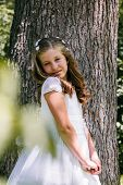 image of communion  - Little Girl in her First Communion Day - JPG