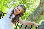 stock photo of communion  - Little Girl in her First Communion Day - JPG