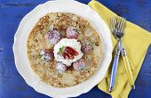 stock photo of tuesday  - Shrove Pancake Tuesday pancakes with strawberries and cream on dark blue vintage shabby chic table - JPG