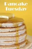 image of tuesday  - Shrove Pancake Tuesday stack of pancakes with honey and butter on yellow and aqua blue vintage shabby chic table closeup with text. 