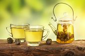 picture of teapot  - Flowering tea in a teapot on a wooden table - JPG