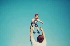 pic of father child  - Vintage photo happy father and child having fun outdoors summer sun blue sky family travel vacation childhood father - JPG
