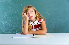 foto of schoolgirl  - Boring sad expression student schoolgirl on classroom desk at school green chalk board - JPG