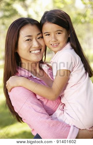 Portrait Asian mother and daughter outdoors