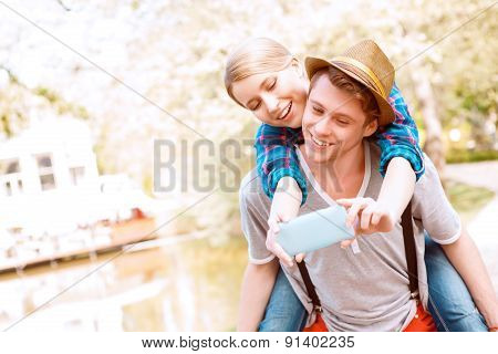 Man carrying his girlfriend on back