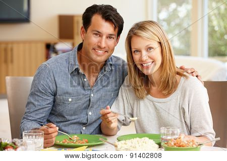 Couple sharing meal