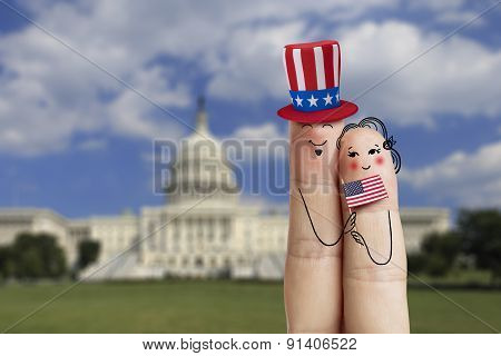 Conceptual Family Finger Art. Couple Is Celebrating July 4Th And Holding Us Flag